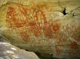 Cathedral Cave  boomerang stencils spade shaped weapon hunters wooden war club red and white nets