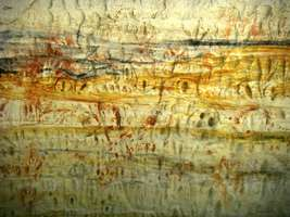 Carnarvon Gorge artwork wall of one thousand vulvas oval bas relief