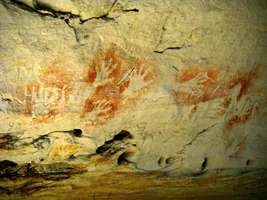 Carnarvon Gorge artwork wall of one thousand vulvas vandals stencilled hands