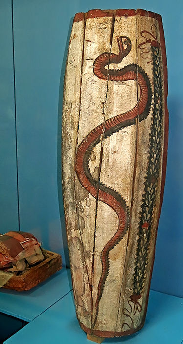 painted mummy in shroud snake coffin